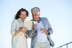 Couple using digital tablet Royalty Free Stock Images