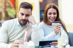 Couple using a digital tablet for online shopping. Royalty Free Stock Photography