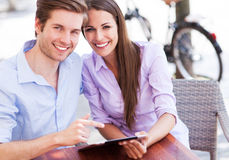 Couple using digital tablet outdoors Stock Photo