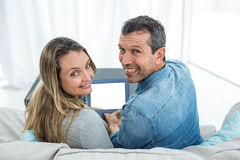 Couple using digital tablet Royalty Free Stock Image