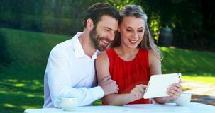 Couple using digital tablet in a restaurant 4k. Happy couple using digital tablet in a restaurant 4k stock video footage