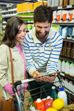 Couple using digital tablet while shopping Royalty Free Stock Photos