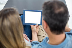Couple using digital tablet Stock Images