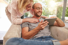 Couple using a digital tablet smiling Stock Photo