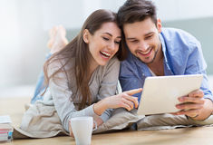 Couple using digital tablet together Royalty Free Stock Images