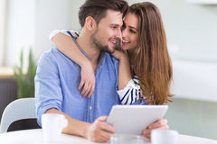 Couple using digital tablet together Stock Images