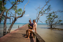 Couple using digital tablet in tropical settings Royalty Free Stock Images