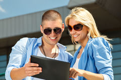 Couple using a digital tablet Royalty Free Stock Images