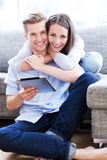 Couple using digital tablet Stock Photo