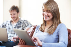 Couple Using Digital Technology At Home Royalty Free Stock Photos