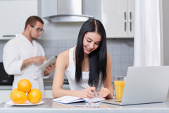 Couple using gadgets and planning day. Stock Photo