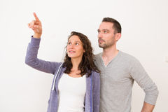 Couple using imaginary touchscreen interface Stock Photography