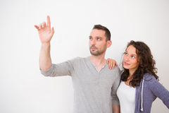 Couple using imaginary touchscreen interface Stock Images