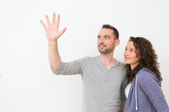 Couple using imaginary touchscreen interface Royalty Free Stock Photos