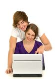 Couple using laptop Stock Images