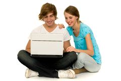 Couple using laptop. Couple with laptop, sitting on floor Stock Image
