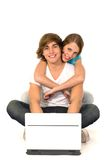 Couple using laptop. Couple with laptop, sitting on floor Stock Photography