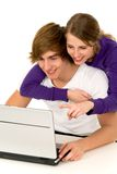 Couple using laptop. Happy young couple using a laptop computer Stock Photo