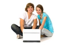 Couple using laptop. Happy young couple using a laptop computer Royalty Free Stock Images