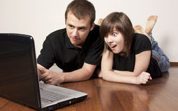 Couple using a laptop Stock Images