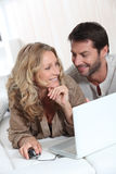 Couple using a laptop Stock Photos