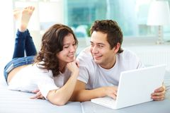 Couple using laptop stock photo