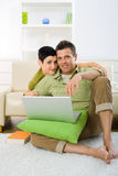 Couple using laptop Stock Image