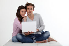 Couple using a laptop Royalty Free Stock Photo