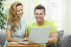 Couple using laptop computer Stock Images
