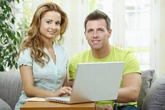 Couple using laptop computer Royalty Free Stock Photo