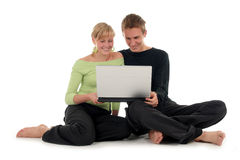 Couple using laptop computer. Couple with laptop, sitting on floor Royalty Free Stock Photos