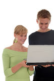 Couple using laptop computer. Young couple using laptop computer Royalty Free Stock Image