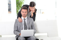 Couple using a laptop computer Stock Image
