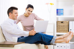 Couple using laptop computer Royalty Free Stock Photo