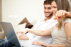 Couple using a laptop computer Royalty Free Stock Image