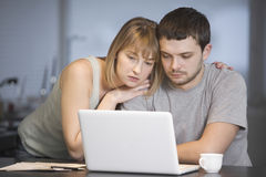 Couple Using Laptop At Desk Stock Photography
