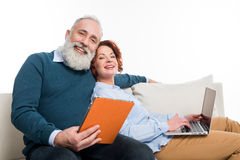 Couple using laptop and digital tablet Stock Image