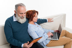 Couple using laptop and digital tablet Royalty Free Stock Image