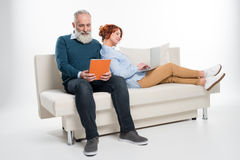Couple using laptop and digital tablet Royalty Free Stock Photography
