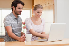 Couple using a laptop while having coffee Stock Photo