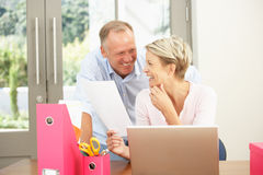 Couple Using Laptop At Home. Couple Using A Laptop At Home Royalty Free Stock Images