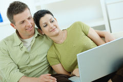 Couple using laptop at home Stock Photo