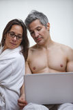 Couple using a laptop at home Royalty Free Stock Photo