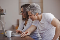 Couple using a laptop at home Stock Image
