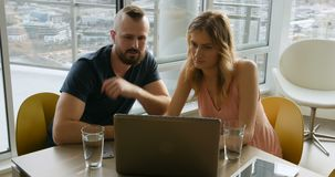 Couple using laptop in living room 4k stock video