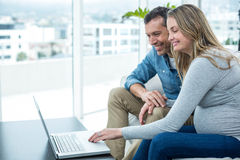 Couple using laptop in living room Royalty Free Stock Photo