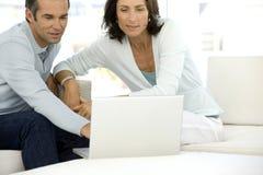 Couple using laptop Stock Photos