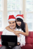 Couple using laptop for ordering online Stock Photo