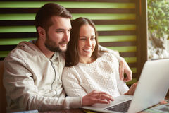 Couple using laptop in restaurant Royalty Free Stock Image