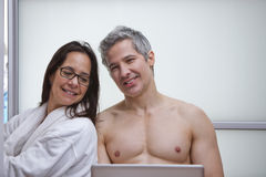 Couple using a laptop at home Stock Photography